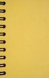 笔记本成螺旋形黄色 免版税库存照片