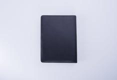 笔记本或黑皮革笔记本在blackground 图库摄影