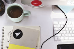 笔记本有起始的品牌商标创造性的设计想法 免版税图库摄影