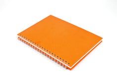 笔记本桔子 库存图片