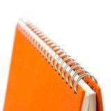 笔记本桔子 库存照片