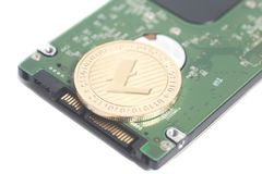 笔记本的计算机硬盘驱动器硬盘驱动器有Litecoin的 免版税图库摄影