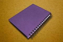 笔记本紫色 图库摄影