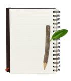 笔记本铅笔木头 免版税库存照片