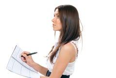 笔记本附注采取课本妇女文字 库存照片