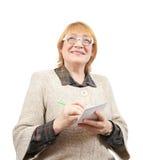笔记本高级妇女文字 免版税库存图片
