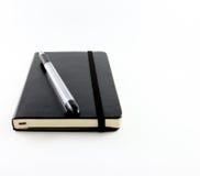 黑笔记本 图库摄影