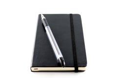 黑笔记本 免版税库存图片