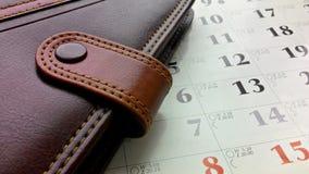 笔记薄和日历 免版税图库摄影