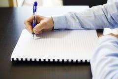 笔记采取-文书工作 免版税图库摄影