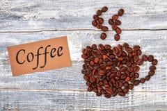 笔记,从咖啡豆的杯子 免版税库存图片
