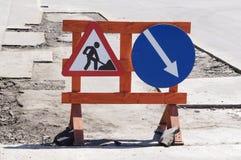 符号前面警告工作 免版税图库摄影