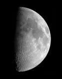 第一个月亮季度 库存照片