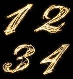 第一个,两,三,四,做由闪烁发光物 查出在黑色背景 库存图片