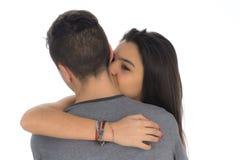 第一次拥抱男孩的少年妇女她喜欢II 免版税图库摄影