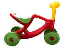 第一辆与绿色轮子的自行车塑料红色,在白色背景 图库摄影