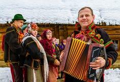 第七种族节日圣诞节在老村庄颂歌 免版税图库摄影