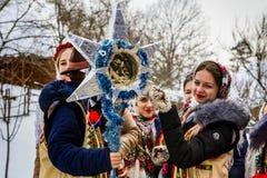 第七种族节日圣诞节在老村庄颂歌 免版税库存照片