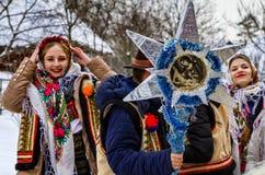 第七种族节日圣诞节在老村庄颂歌 库存照片