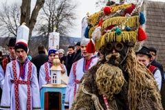 第八种族节日圣诞节在老村庄颂歌 免版税图库摄影