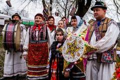 第八种族节日圣诞节在老村庄颂歌 免版税库存图片