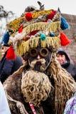 第八种族节日圣诞节在老村庄颂歌 免版税库存照片