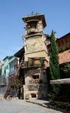 第比利斯的木偶剧院,乔治亚落的钟楼  免版税图库摄影