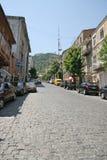 在英王乔治一世至三世时期首都的小被修补的街道 免版税库存图片