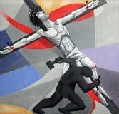 第11个苦路,在十字架上钉死:耶稣被钉牢对十字架 免版税库存图片