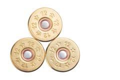 第12口径的三枚子弹的概念寻找的在白色背景隔绝的步枪 免版税库存图片