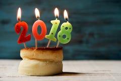 第2018年,作为新年,在蛋糕 库存图片