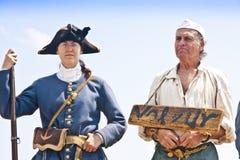 第17世纪罪犯和卫兵 免版税库存图片