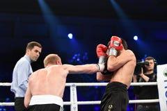 等级拳击战斗在体育宫殿  免版税库存图片