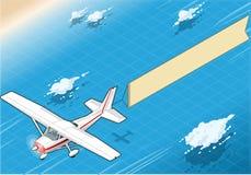 等量转换型飞机在飞行中有在正面图的空中横幅的 免版税图库摄影