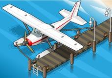 等量水上飞机被停泊在正面图的码头 免版税库存图片