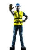 建筑工人中止姿态安全背心剪影 库存图片