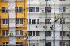 建筑工人队  库存图片