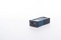建筑工具或激光测距仪在背景 免版税库存照片