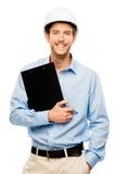 建筑工地的愉快的年轻工头有安全帽白色backgro的 库存图片