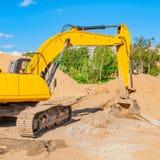 建筑挖掘机站点黄色 免版税库存照片