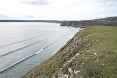 筒形波浪, Southgate, Gower Penonsular,英国 免版税库存图片