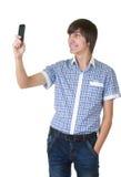 答复的愉快的人电话 免版税库存照片
