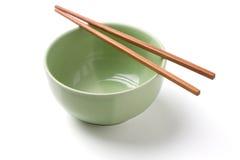 筷子和绿色碗 库存照片