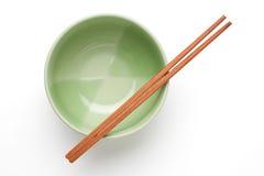 筷子和绿色碗 库存图片