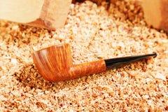 筹码管道被擦亮的抽烟的木头 免版税库存照片