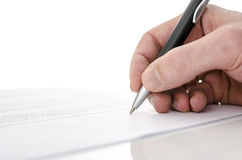 签合同的一个人的详细资料 免版税库存照片