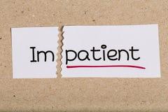 签字与词不耐烦把变成患者 免版税库存图片