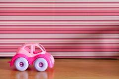 简单的塑料汽车桃红色 图库摄影