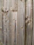 简单的没有漆的木篱芭盘区 免版税库存图片