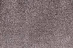 简单的灰色颜色地毯纹理 苍白光滑的地毯 天鹅绒纸背景 免版税库存图片